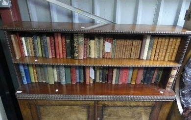A Victorian rosewood Bookcase, two open shelves upon two doo...
