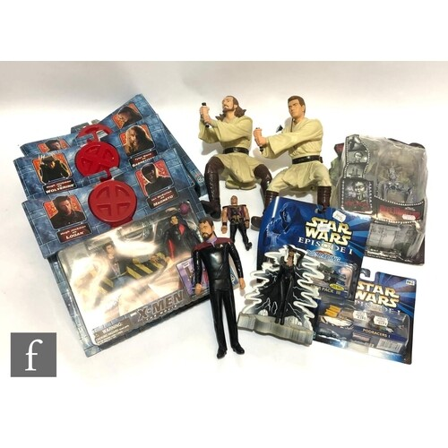 A collection of assorted action figures, including four Toy ...