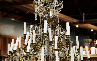 A monumental gilt bronze and crystal 24 light tiered chandelier