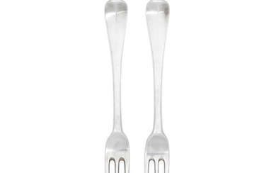 A pair of George III Irish silver Hanoverian pattern three-pronged table forks