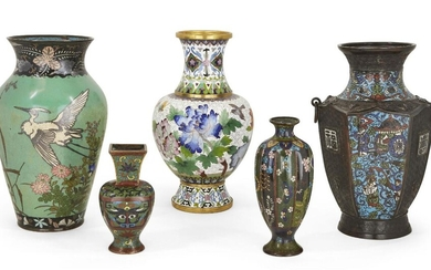 Five Japanese and Chinese cloisonné enamel vases, 19th century, to include a Japanese green enamel vase decorated with herons and iris, a Japanese white baluster vase of cherry blossom and peonies; together with three further Chinese cloisonné...