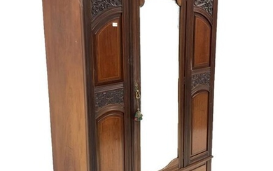 Late Victorian mahogany wardrobe, projecting cornice over panelled and...