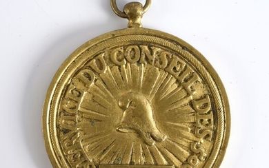 """MEDAL OF THE SERVICE OF THE COUNCIL OF THE FIVE HUNDRED.In cast and gilt bronze attributed to Captain Laurence; decorated with a Phrygian cap on a radiating background surrounded by the inscription """"Service du conseil des500"""", and below, in a..."""