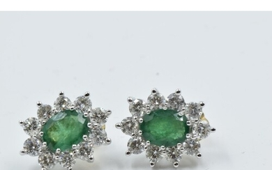 Pair of yellow and white gold oval emerald and diamond clust...