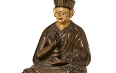 Property of a Gentleman (lots 36-85) A Tibetan copper alloy figure of a Karmapa, 18th century, wearing a three-peaked crown with painted face and features, holding a vajra in his right hand to his chest and a jar in his left hand in his lap seated...