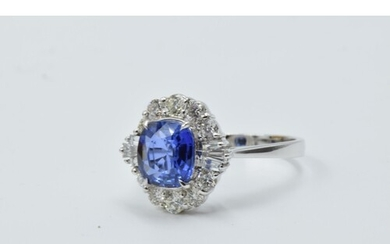 18ct White gold oval tanzanite and diamond cluster ring, the...