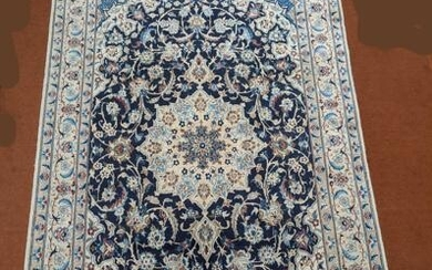 A North-West Persian Sarouk rug, double pendant