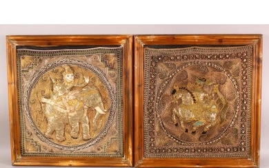 A PAIR OF FRAMED INDIAN EMBROIDERED PANELS, each centre with...
