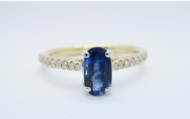 A Sapphire and Diamond Ring claw-set oval-cut sapphire, 0.94...