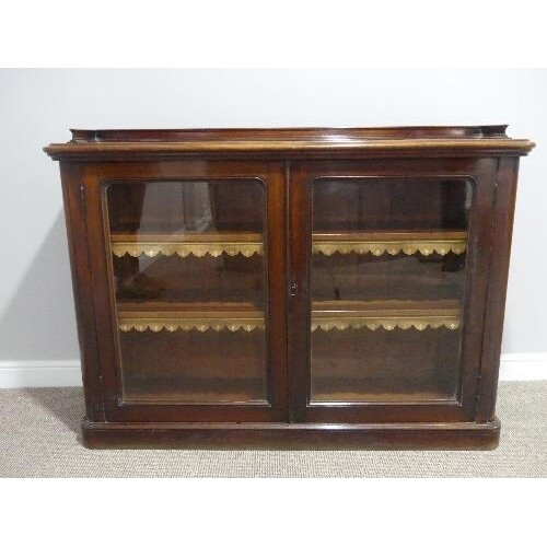 A Victorian mahogany two door glazed Bookcase, the two adjus...