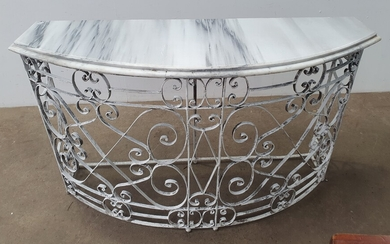 A WROUGHT IRON BASED MARBLE TOP CONSOLE