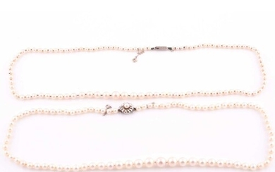 A cultured pearl necklace with white metal clasp, together w...