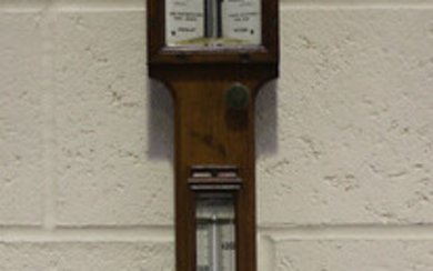 A late Victorian pale oak Admiral Fitzroy's storm stick barometer, the ceramic dial with vernie