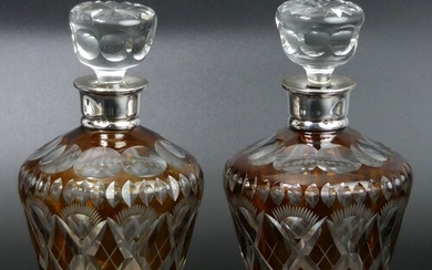 A pair of silver mounted amber flashed and cut glass decante...