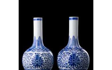 A pair of small blue and white bottle vases, apocryphal qianlong mark (restorations) China, late Qing dynasty/Republic Period (1912-1949) (h.…Read more