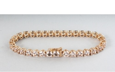 AN 18CT ROSE GOLD THIRTY-TWO STONE MORGANITE (16.65cts) LINE...