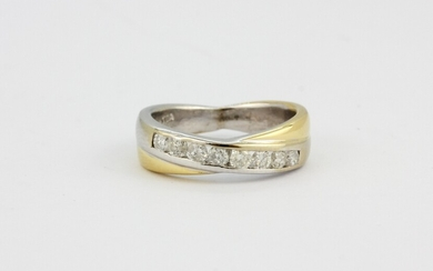 An 18ct yellow and white gold diamond set crossover ring, approx. 0.50ct, approx. 6.7gr, (M).