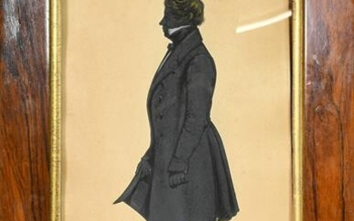 An Early 19th Century Silhouette of a Gentleman, standing wearing...