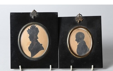 An early 19th century cut paper silhouette of an unknown gen...