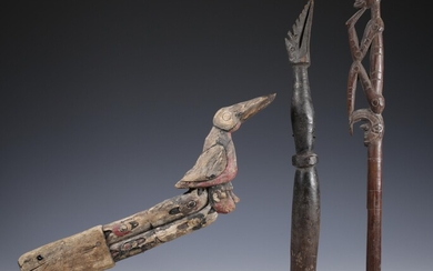 Papua, Wakda-Yamna, prow ornament, an Asmat top of an implement with human figure and a...