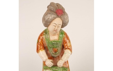 Tang style 'Orange dress' glazed and painted Earthenware cou...