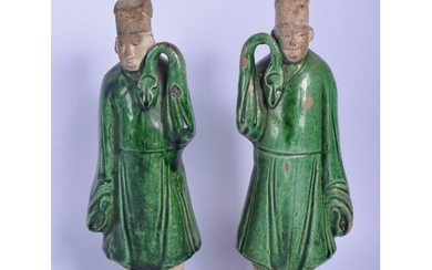 A PAIR OF 19TH CENTURY CHINESE GREEN GLAZED POTTERY FIGURES ...