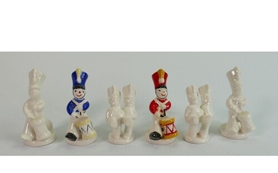A collection of Beswick toy soldier figures :in blue, red an...