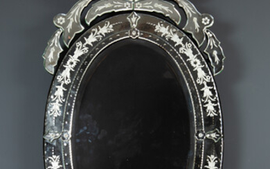 A contemporary Venetian style oval wall mirror