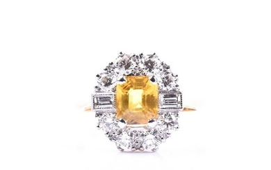 A diamond and yellow sapphire cluster ring, set with a mixed...