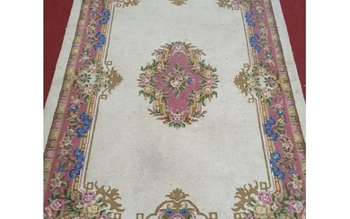 A large Cream ground Carpet with pink and blues. 278 x 183cm...