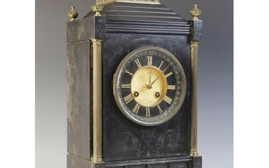 A late 19th century French slate mantel clock, the architec...