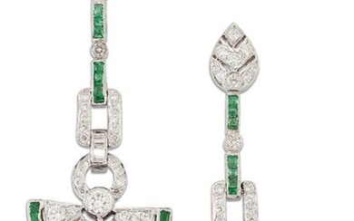 A pair of emerald and diamond drop earrings, the brilliant-cut diamond pierced fan shaped drops with calibre emerald edging, one emerald deficient, to brilliant- and baguette-cut diamond and calibre emerald articulated link and line suspensions and...