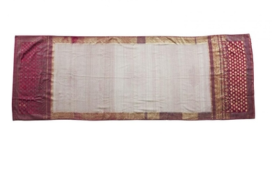 A shoulder cloth or Selendang (ceremonial robe), Sumatra, Indonesia, 20th century, the scarlet silk ground woven with a white and red lattice grid to the field, within borders worked with gilt metal stars and ogival motifs, 96 x 270 cm. Provenance:...