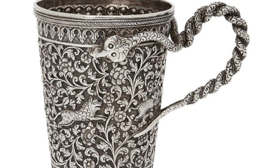 A silver Kutch engraved tankard with snake handle, Kutch, Northwest India, circa 1860, the repoussé decoration with a central register of profuse scrolling foliated tendrils bearing floral blooms with leaping animals, between two registers of...