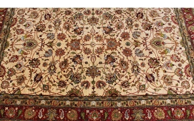 A woollen carpet, worked in the traditional manner with styl...