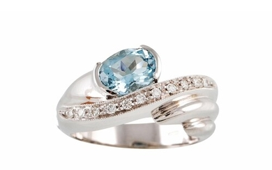 AN AQUAMARINE AND DIAMOND RING, of twist design, set with an...