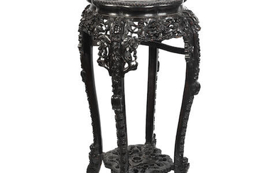 An early 20th century Chinese carved hardwood and rouge marble inset jardinière stand