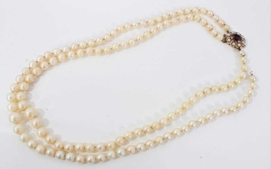 Cultured pearl two strand necklace with amethyst and pearl clasp