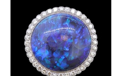 IMPORTANT BLACK OPAL AND DIAMOND CLUSTER RING, set with a ro...