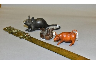 TWO WOODEN NETSUKE IN THE FORM OF AN OX AND THREE RATS AND T...