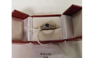 A 14ct white gold ring inset with sapphire and diamonds, siz...