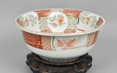 A 19th century Chinese famille verte bowl on hardwood stand,...
