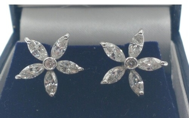 A BEAUTIFUL A pair of 18ct white and diamond flower shaped e...