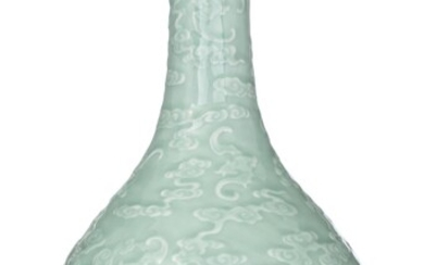A Chinese incised celadon pear-shaped bottle vase, with a Qianlong mark, 19thC, H 40,5 cm