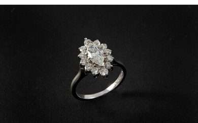 A DIAMOND MARQUISE-SHAPED CLUSTER RING the marquise-shaped d...