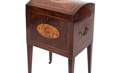 A George III mahogany and inlaid domed trunk shaped decanter...