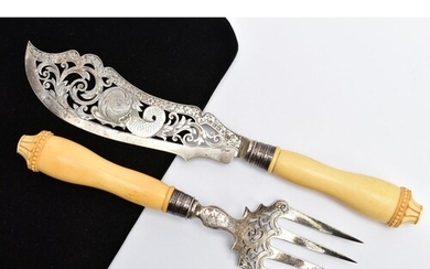 A VICTORIAN SILVER AND IVORY HANDLED FISH KNIFE AND FORK SER...