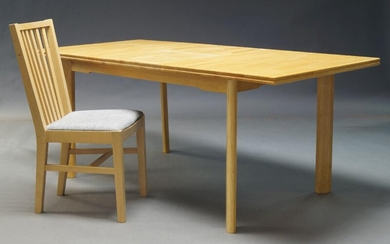 A contemporary blond wood extending dining table, the rectangular top with central fold out extension on rounded supports, together with six slat back dining chairs (7)