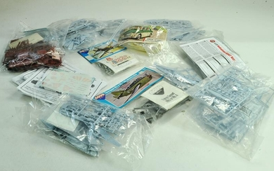 A group of plastic model kits comprising various