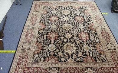 A large hand-knotted Persian-style wool Rug, black ground wi...